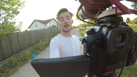 Nervous vlogger walking and complaining about his noisy neighbors while filming Live Action