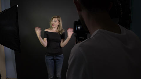 Young cameraman recording an attractive young beautiful woman talking to the Footage