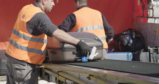 Tel Aviv, Israel - January 2018. Workers offloading luggage from airline jet GIF