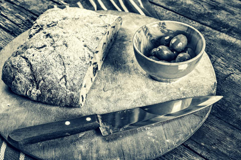Healthy food, Olive bread, cut, wooden table, Ciabatta, Close up フォト