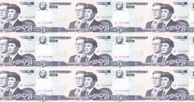 Banknotes of five wons of North Korea rolling, cash money, loop Animation