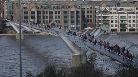 People walking over Millennium Bridge - LONDON, ENGLAND Live Action