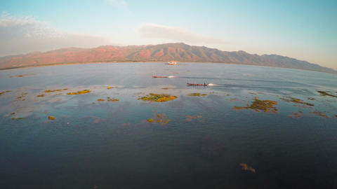 Flying over boats on Inle Lake at sunset Footage