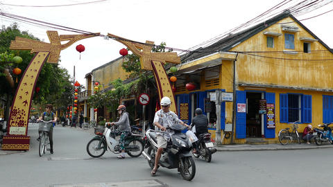 Motorbikes and bicycles at a crossroad in the old town of Hoi An Footage