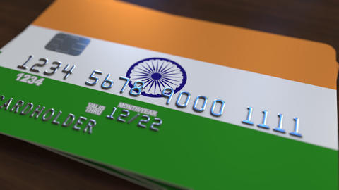 Plastic bank card featuring flag of India. National banking system related Footage