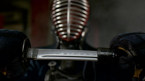 Kendo warrior demonstrates fighting attacks Footage