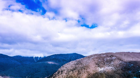 Snowy mountains in Sunny day. timelapse Live Action