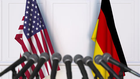 Flags of the USA and Germany at international meeting or negotiations press Footage