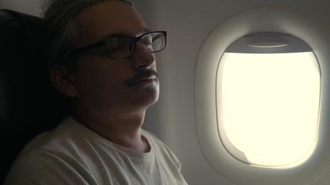 Man sleeping inthe plane Footage