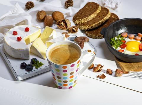 black coffee with brown foam in a white ceramic mug Photo