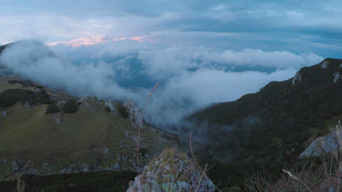 Amazing time lapse cloudscape with mysterious fog flying over mountain highland Live Action