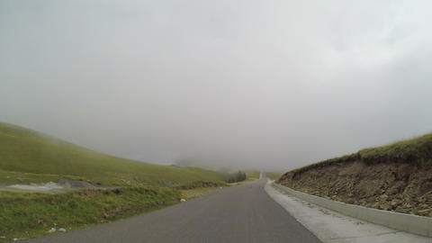 Pov of beautiful country route seen from car traveling through the fog concept Footage