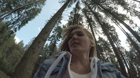 POV of a frightened young woman escaping from a killer chasing her in woods Footage