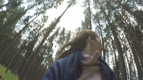 POV of chased panicked young woman running away in mountain wood Footage