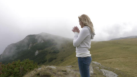 Amazed hiker woman admiring the the mountain top beauty observing the valley and Footage