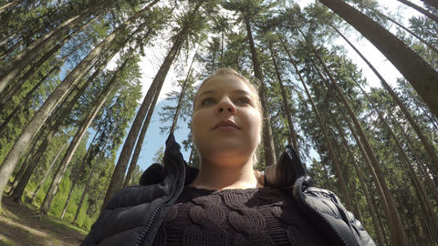 Relaxed trekker woman taking deep breath of fresh air in a mountain forest on Live Action