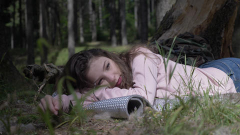 Leisure of the beautiful camping girl lying down and chilling on the grass deep Footage