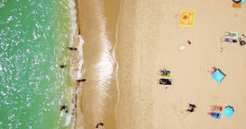 Aerial Footage From Flying Drone Of People Relaxing On Beach Footage
