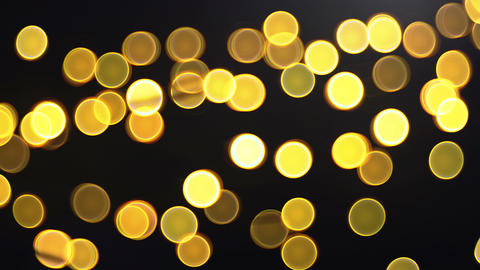 panning, zooming golden bubble bokeh on black background Footage