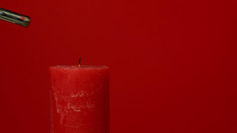 Close up vivid red candle trembling flame Footage