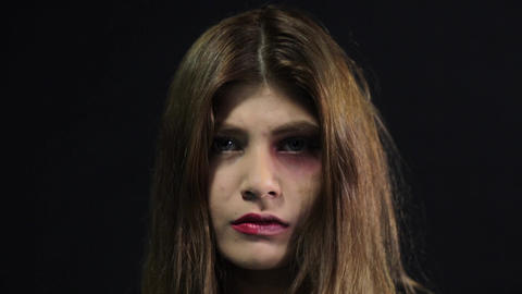 Unhappy sad woman. Domestic violence and abuse concept Footage