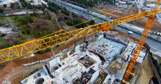 Aerial video footage of a construction crane at a construction site Live Action