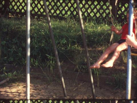 Boy on swing Footage