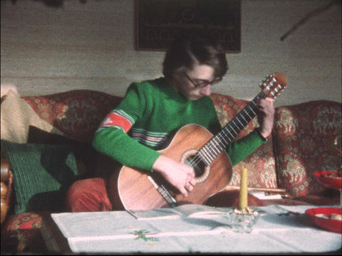 Boy playing guitar Live Action