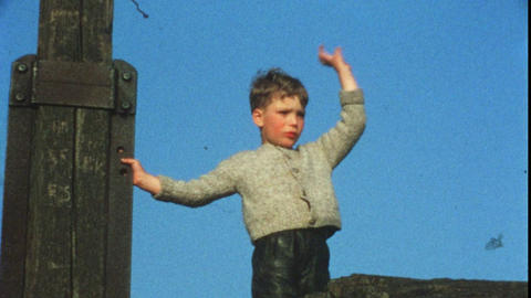 Boy waving goodbye 2 Live Action