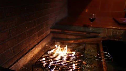 Barbecue with fire and glass of wine Stock Video Footage
