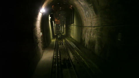 Moving funicular in subway tunnel, cabin view Stock Video Footage