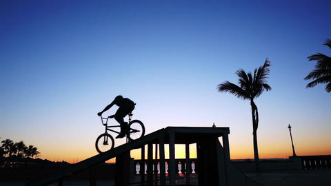 BMX Biker Silhouette Doing a 360 Stock Video Footage
