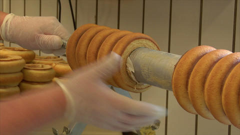 german confectioner takes baumkuchen cake from role 10795 Stock Video Footage