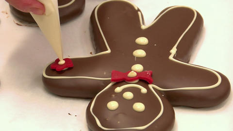 confectioner decorate gingerbread man marzipan 10805 Stock Video Footage