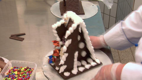confectioner decorate gingerbread house time lapse top 10807 Footage