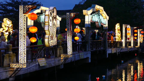 The Cau An Hoi bridge in the evening with Floating lanterns in the water Footage