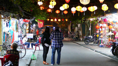Tourists making a selfie in a street with Colorful lanterns in the old town of H Footage