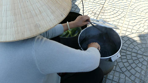 Stirring in a pan with Xi Ma black sesame sweet soup Live Action
