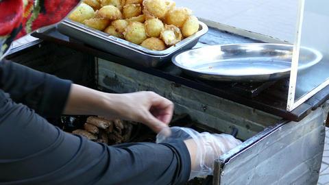 Preparing Banh khot mini savory coconut pancake Footage