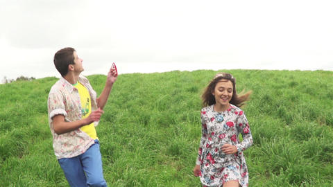 Teenager Boy And Girl Playing With Flying Kite Footage