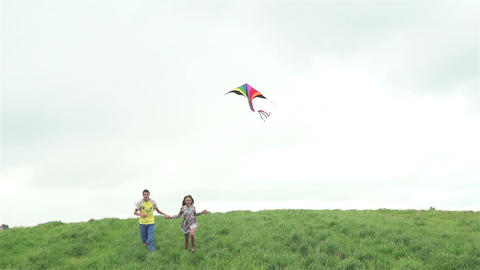 Teens With Kite On A Field In Summer Footage