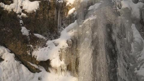 Frozen waterfall stream in cold winter Footage