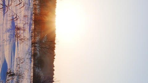 Vertical video. Snowy field. Sunset. Russia Footage