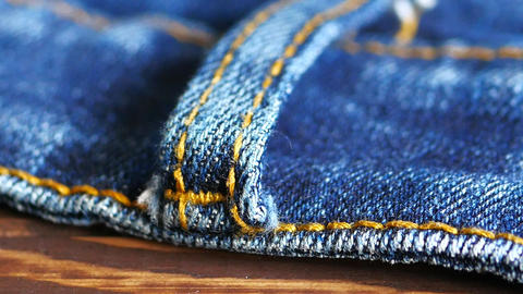 Close up detail of blue denim jeans belt loop texture background Live Action