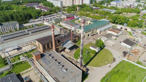 Petroleum Processing Factory against City Buildings Footage