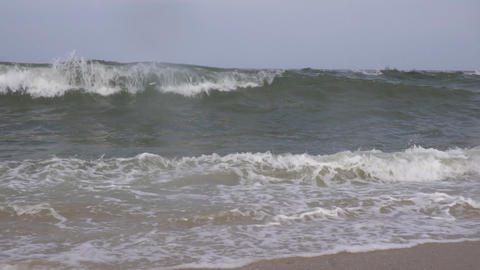 High surf from giant breaking ocean waves driven by high winds slow motion Live Action