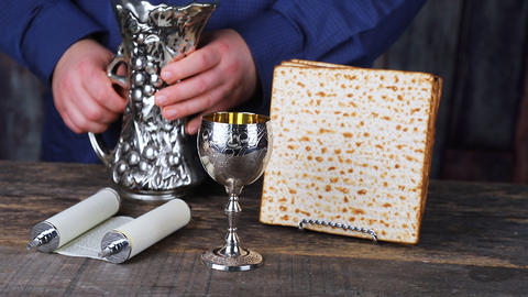 Still-life with wine and matzoh jewish passover bread ビデオ
