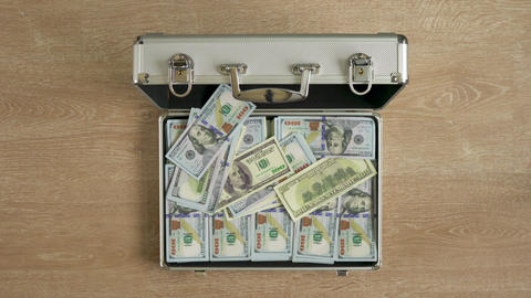Money falls in a suitcase and it closes Footage