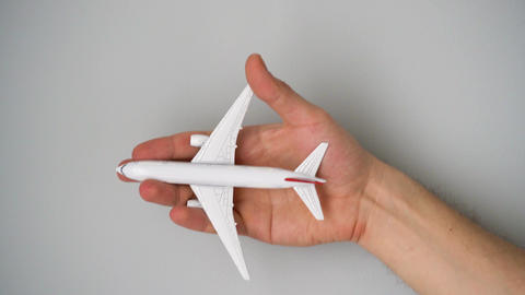 Toy airplane in the hand simulates a flight Footage