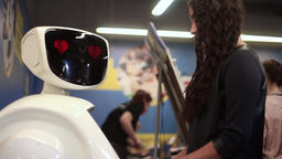 The girl communicates with the robot. Artificial intelligence. Modern robotic Footage